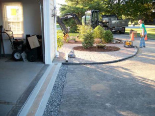 New brick paver walk and poly drain installation Proper installation of poly drain drainage product in front of a garage