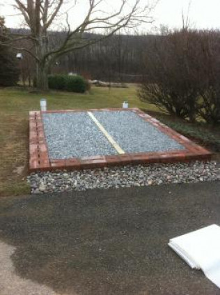 Shed pad with downspout drainage