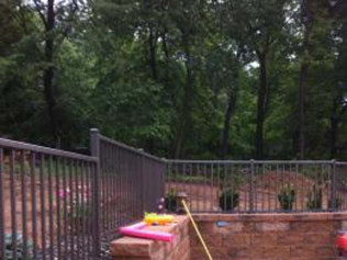 Retaining wall, railing, and landscaping